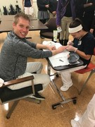 Stephen Sarsany, Beecher HS Counselor allows KACC Student to trim his nails.