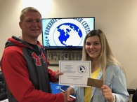 Ava Licka, Medical Terminology-Basic Health Skills Student from Manteno High School Receives her award from KACC Dean, Mr. Papineau