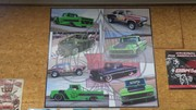 Poster hanging in the Shop with a bunch of specialty cars.