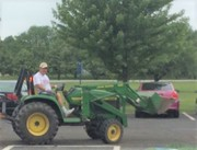 A little fuzzy, but Swede Hamlyn on a Tractor