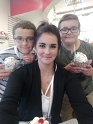 Jamie Posing with her two sons out for ice cream.