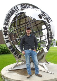 Dalton Grimes standing in front of Career Center's Globe