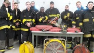 KACC Fire-Rescue-EMR Students wearing the donated Turnout Gear and standing in front of donated equipment.