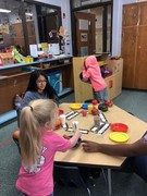 Click on Pic To Open Gallery - ECE Students using imaginary plan in housekeeping - making a turkey fest!